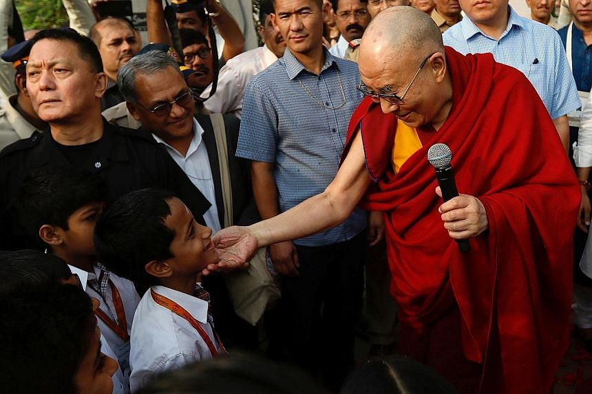 The Dalai Lama with pupils at a Mumbai school last year. India has continued to host the Dalai Lama and his fellow Tibetan Buddhist exiles even though China condemns them as dangerous separatists.