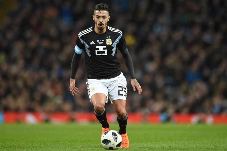 Argentina's midfielder Manuel Lanzini runs with the ball during the International friendly football match between Argentina and Italy at the Etihad stadium in Manchester, north west England on March 23, 2018.