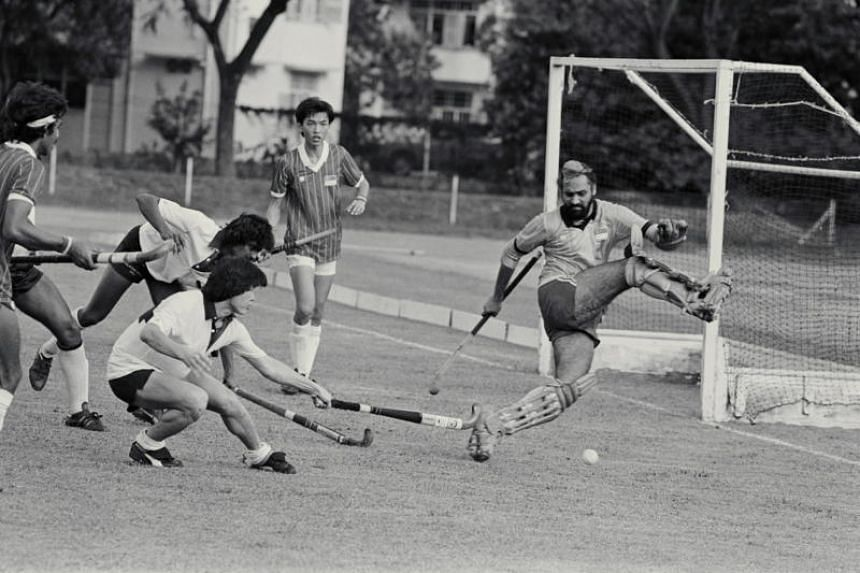A hockey game between Malaysian All Stars and Singapore at the Farrer Park Athletic Centre in 1983.