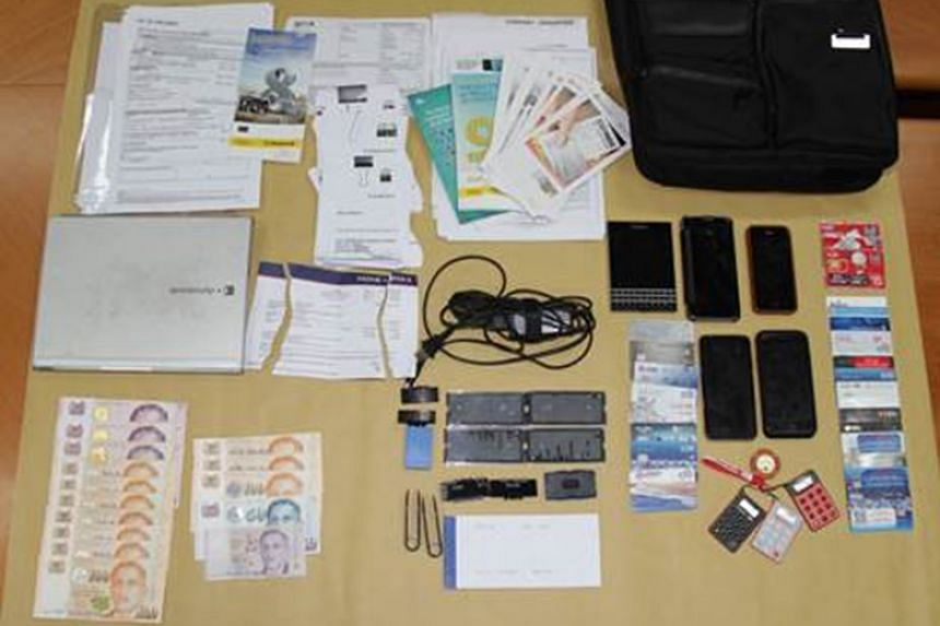 Items seized after the arrests of five men over their suspected involvement in more than 50 cheating cases.
