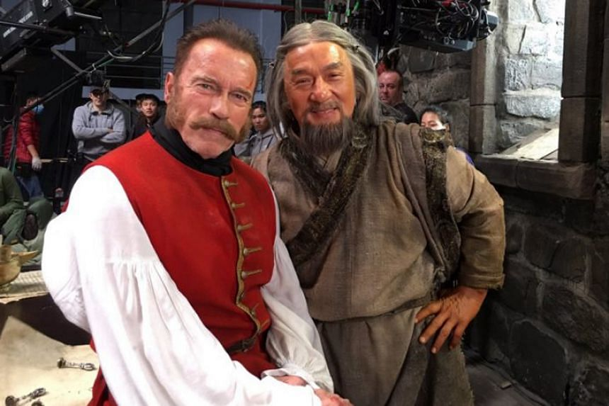 Jackie Chan and Arnold Schwarzenegger behind the scenes on the set of Mystery Of Dragon's Seal: Journey To China.