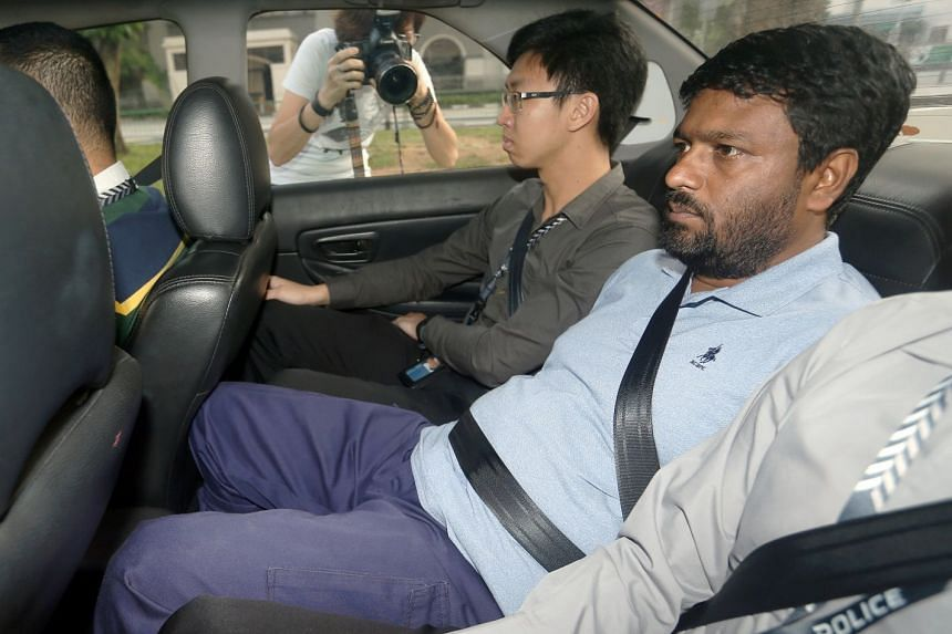 Bahurudeen Kuthpudeen (centre) was charged with one count of criminal breach of trust as servant, on March 31, 2018.