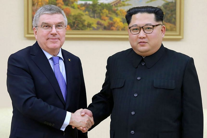 North Korean leader Kim Jong-Un (right) shaking hands with President of the International Olympic Committee Thomas Bach.
