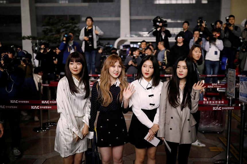 Members of South Korean K-pop girl group Red Velvet leaving for Pyongyang at the Gimpo International airport in Seoul, South Korea, on March 31, 2018.