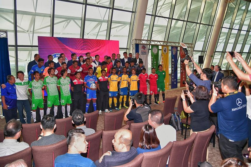 Players and officials from the football clubs at the rebranding of the S-League to the Singapore Premier League last week. Youth development will be a central focus for the league from this season onwards.