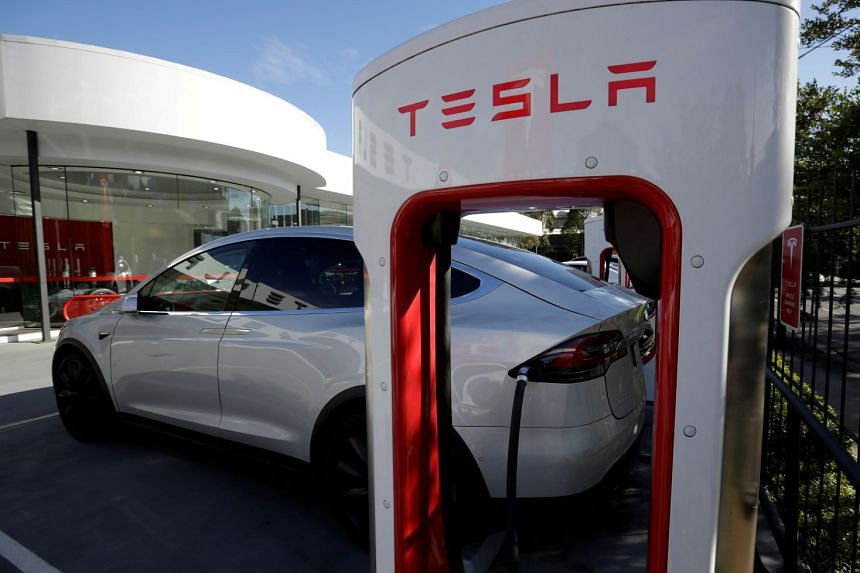 A Tesla Model X vehicle is charged by a supercharger outside a Tesla electric car dealership in Sydney, Australia, on May 31, 2017.