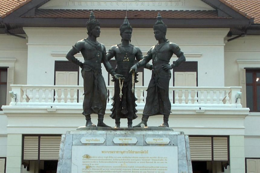 An English-language magazine faced legal action for posting an image on social media of three statues of ancient kings - a Chiang Mai landmark - in pollution masks.