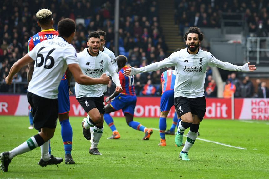 Liverpool's Mohamed Salah celebrates scoring their second goal in the English Premier League match against Crystal Palace at Selhurst Park in London on March 31, 2018.