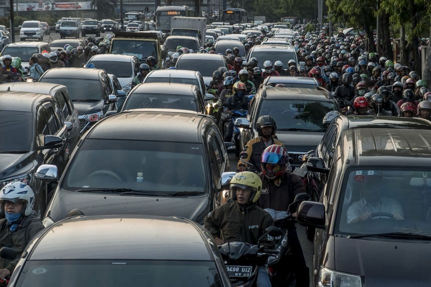 Motorists wait in a traffic jam during afternoon rush hour in Jakarta on Sept 8, 2017.