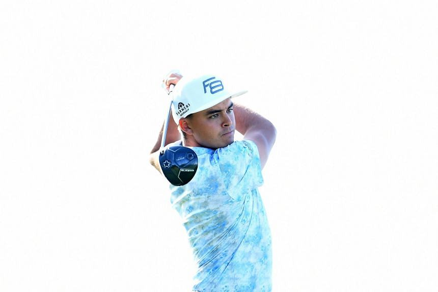 Rickie Fowler hits his tee shot on the 17th hole during the second round of the Houston Open at the Golf Club of Houston, on March 30, 2018.