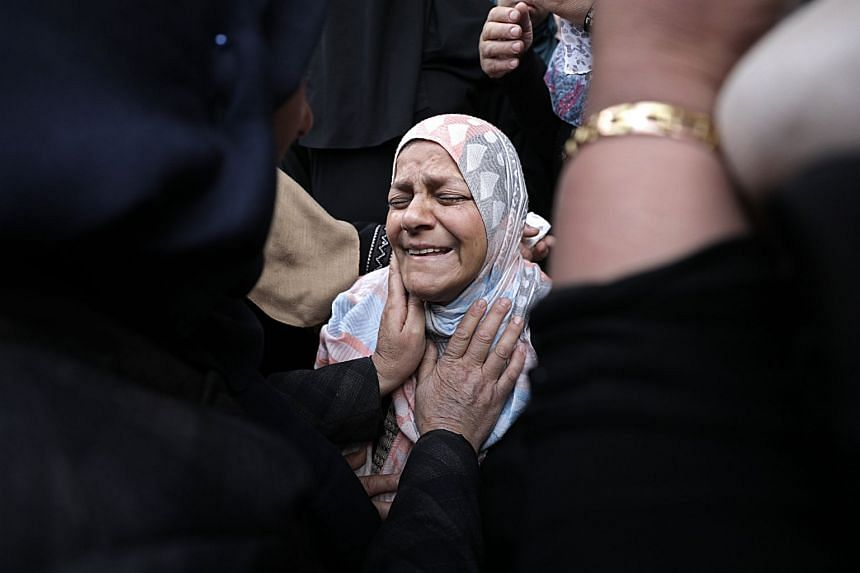 The mother of Jihad Abu Jamous, who was shot dead during clashes with Israeli troops, mourns at his funeral.