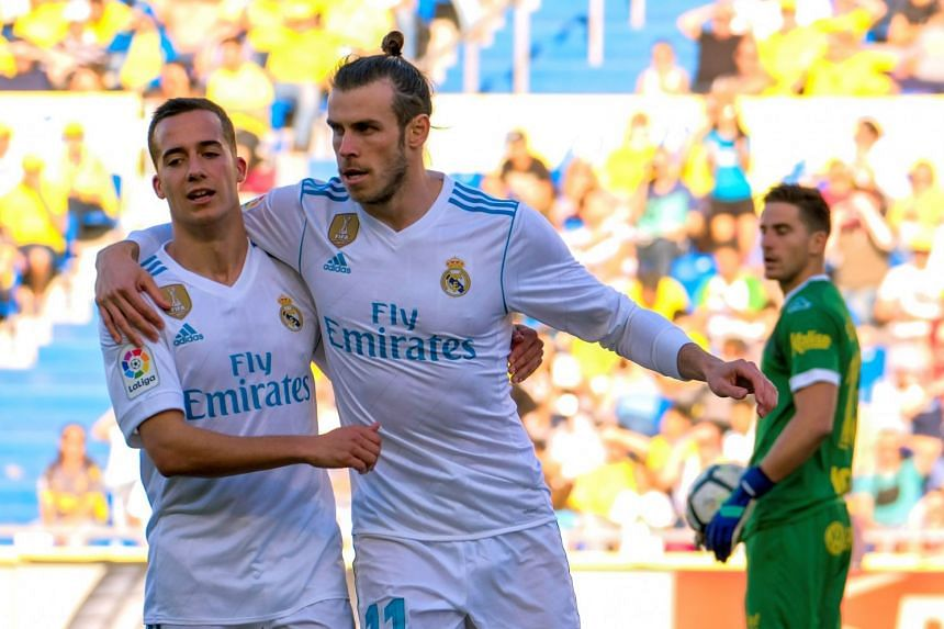 Real Madrid's Gareth Bale (centre) celebrates with Lucas Vazquez after scoring the 3-0 lead.