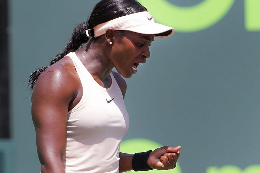 Stephens reacts against Ostapenko during the women's final.