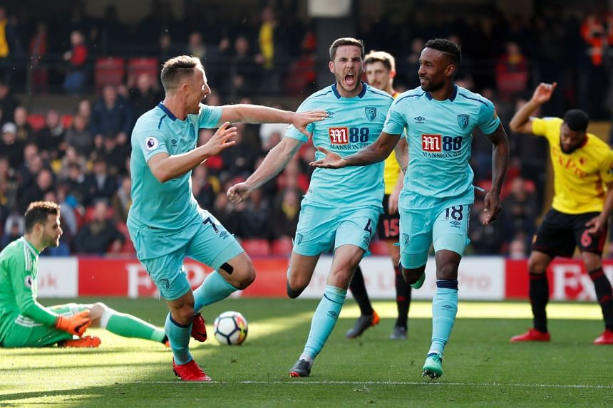 Bournemouth's Jermain Defoe celebrates scoring their second goal with team mates.