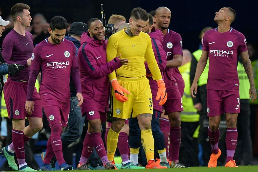 Manchester City's Ederson, Raheem Sterling and teammates celebrate after the match.