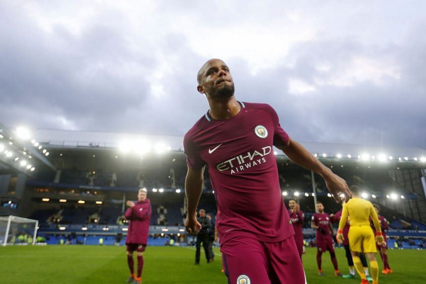 Manchester City's Vincent Kompany celebrates after the match.