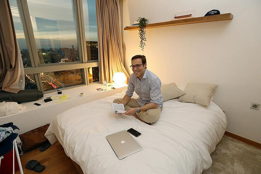 Mr Edouard Chamorel, 26, in his One Shenton apartment run by Hmlet, which handles 50 apartments and three buildings in Shenton Way, Raffles Place, River Valley and Joo Chiat. It organises rooftop parties for clients.