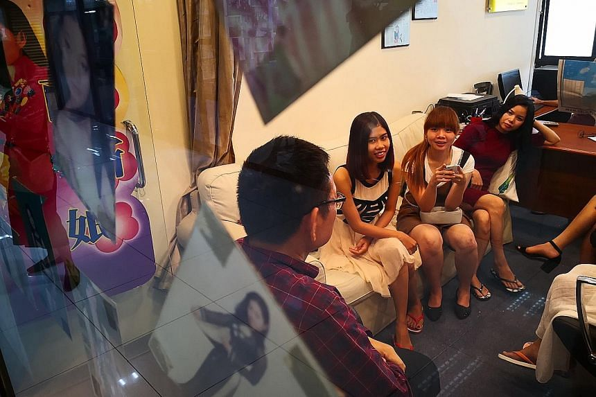 (From left) Ms Tran Thi Nhi, 27, Ms Tran Hue Linh, 28, and Ms Vo Thi Thuy, 29, at True Love Vietnam Brides Matchmaker to find Singaporean husbands.