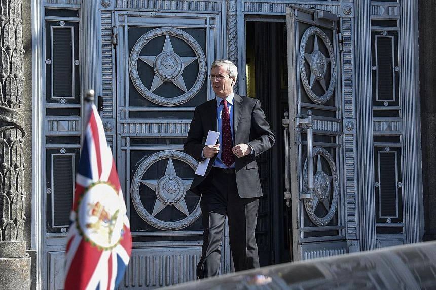 British ambassador to Russia Laurie Bristow leaving the Russian Foreign Ministry in Moscow on Friday, after being told he had one month to further cut Britain's diplomatic contingent in Russia to the same size as the Russian mission in Britain.