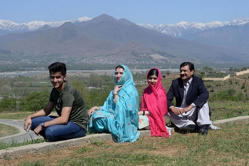 Ms Malala Yousafzai with her father Ziauddin Yousafzai, mother Torpekai and brother Atal during her hometown visit yesterday.