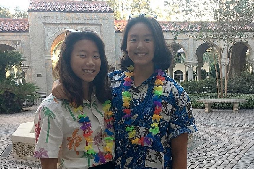 Sisters Faith (left) and Ashley Khoo dressing up for homecoming week at the Bolles School in Florida, where they are based.