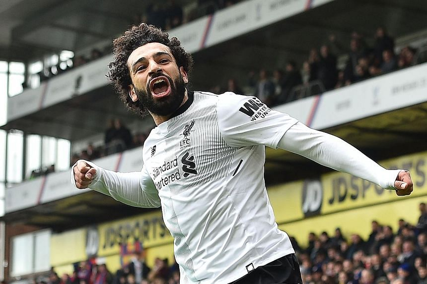 Liverpool's Mohamed Salah celebrates scoring the winning goal in their Premier League match at Crystal Palace yesterday. It was his 29th league goal of the season.