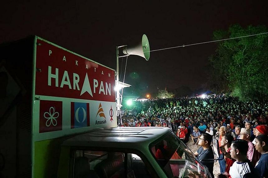 """The crowd at opposition group Pakatan Harapan's rally in Perlis last Friday. Its leaders are hoping for a """"Malay tsunami"""", in which Malay voters opt en masse for the opposition."""