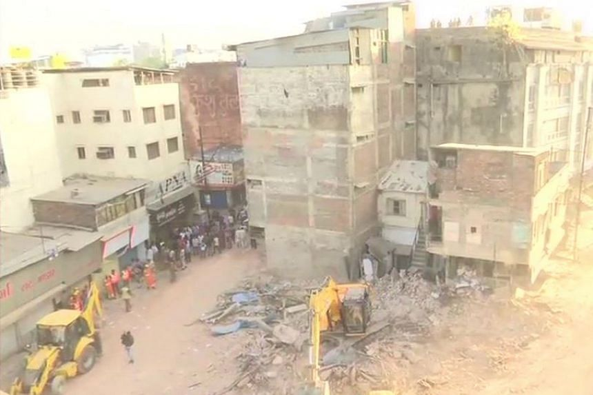 Local media reports said the collapse took place after a car drove into the building's front portion.