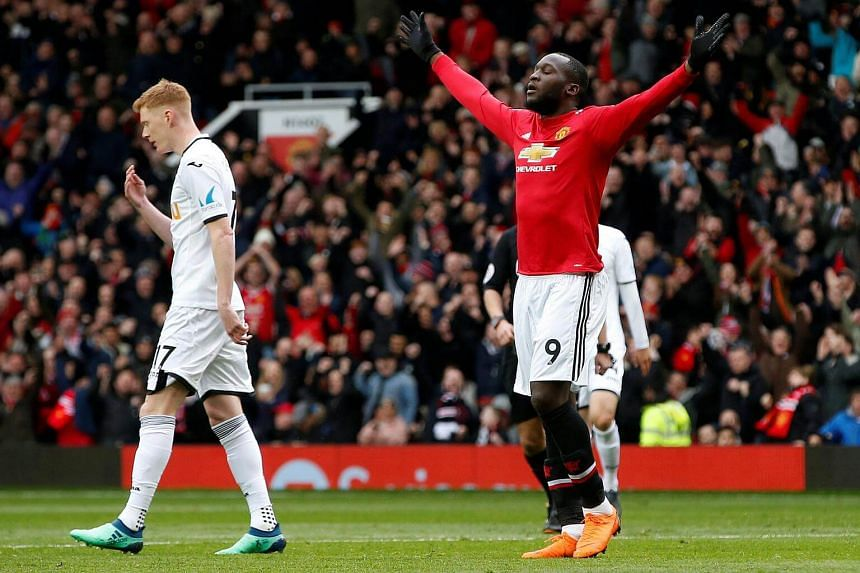 Manchester United's Romelu Lukaku celebrates scoring their first goal during their English Premier League match against Swansea City at Old Trafford Stadium in Manchester, on March 31, 2018.