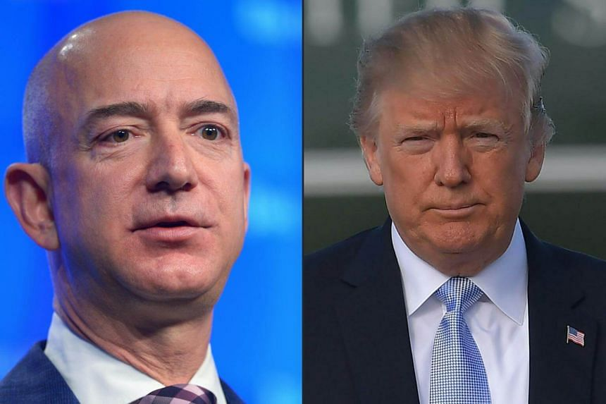 """US President Donald Trump (right) is reportedly """"obsessed"""" with regulating the e-commerce giant, whose founder and chief executive officer Jeff Bezos also owns the Washington Post newspaper."""