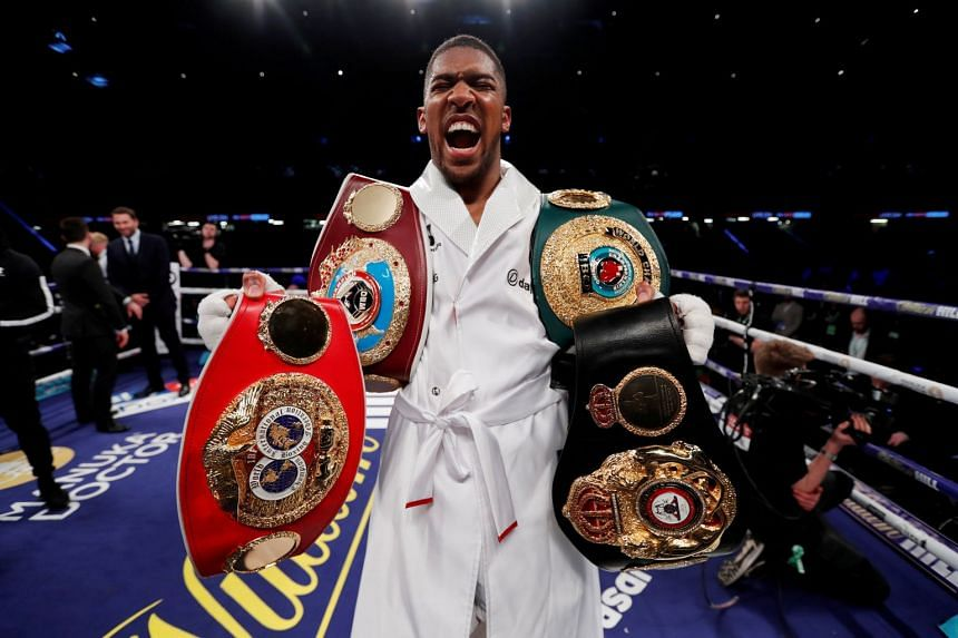 Boxer Anthony Joshua celebrating with the belts after winning the fight against Joseph Parker, on March 31, 2018.