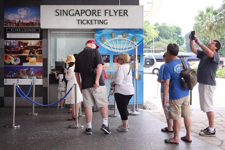 Tourists queueing up to buy tickets for the Singapore Flyer, on April 1, 2018.