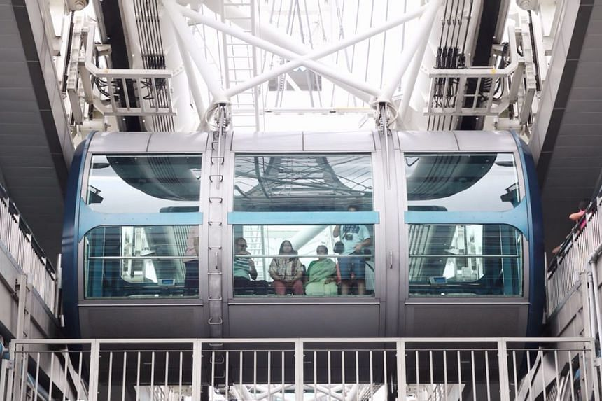 Passengers on board one of the Singapore Flyer's capsules, after the attraction was reopened for business on April 1, 2018.