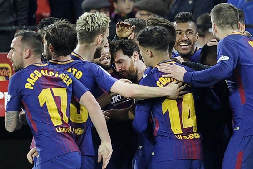 Messi (centre) celebrates scoring with team mates.