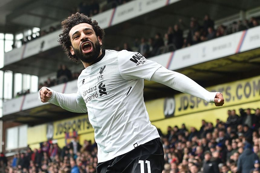 Liverpool's Egyptian midfielder Mohamed Salah celebrates scoring the team's second goal.