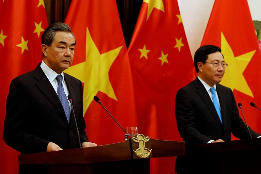 Foreign Minister Wang Yi (left) and Vietnamese Foreign Minister Pham Binh Minh speaking at a joint news conference in Hanoi on April 1, 2018.
