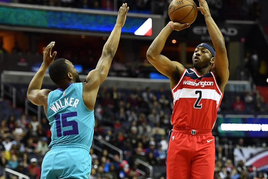 Washington Wizards guard John Wall (#2) shooting over Charlotte Hornets guard Kemba Walker (#15) during their NBA game on March 31, 2018.