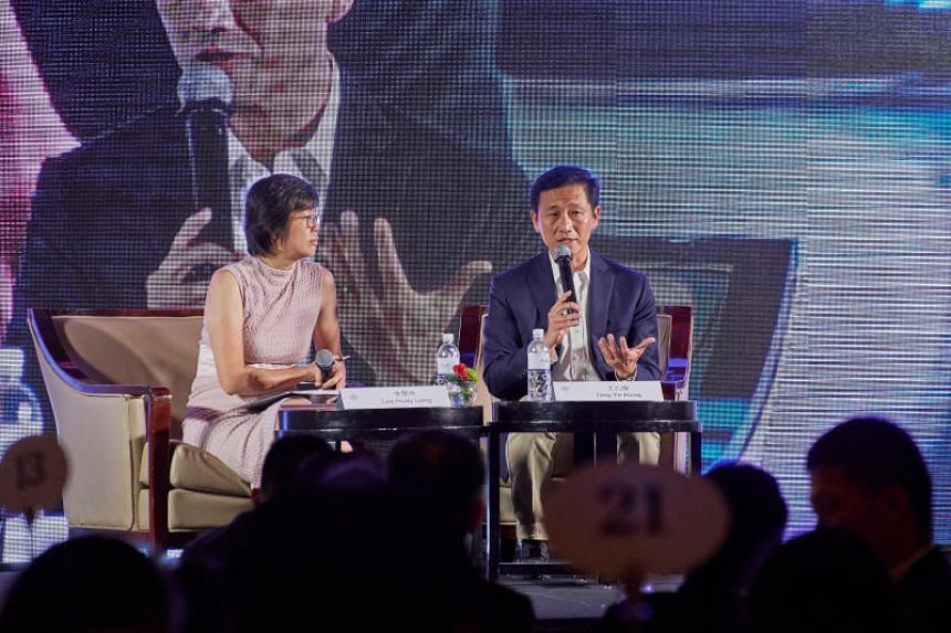 Education Minister (Higher Education and Skills) Ong Ye Kung, flanked by Ms Lee Huay Leng, head of Singapore Press Holdings' Chinese Media Group, speaking at a dialogue session at Raffles City Convention Centre on April 1, 2018.