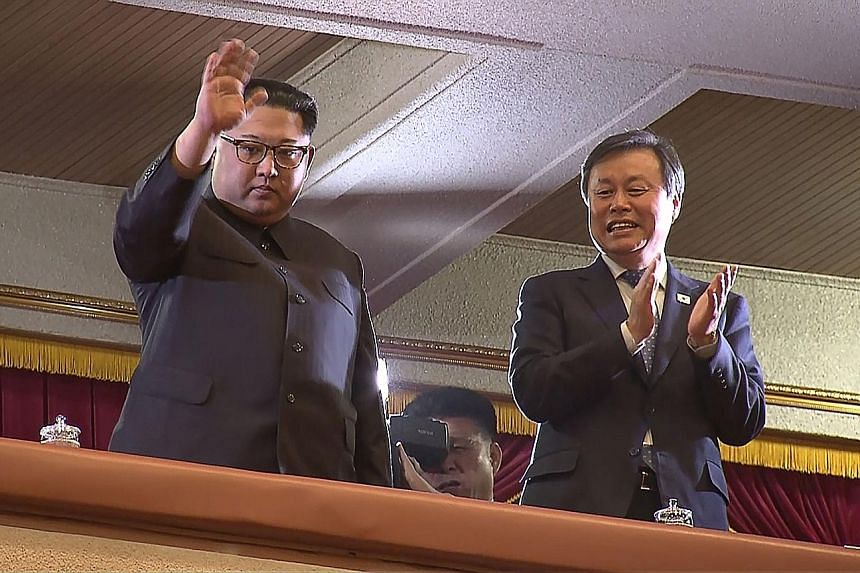 Video footage from Korea Pool reporters showing North Korean leader Kim Jong Un and South Korea's Culture, Sports and Tourism Minister Do Jong Whan at yesterday's concert.