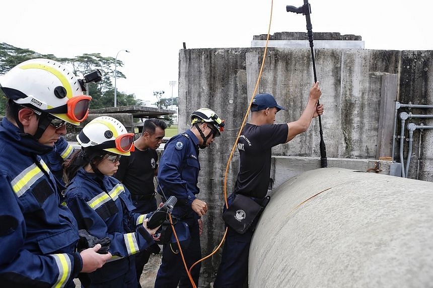 """From left: Reporter Gracia Lee viewing an image of a """"survivor"""" trapped under the debris of a collapsed structure; and negotiating a confined space to rescue the casualty; a rescue dog being unleashed to sniff out a trapped """"survivor"""". Reporter Graci"""