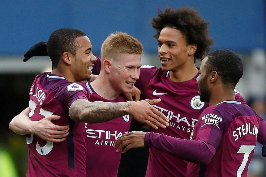 Kevin de Bruyne celebrating with Manchester City's three scorers against Everton - Gabriel Jesus (far left), Leroy Sane and Raheem Sterling. City can seal the EPL title by beating United in Saturday's Manchester derby but, before that, they take on L