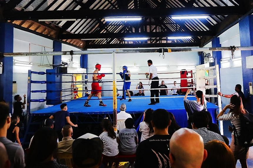 A 120-strong crowd gathering at the Farrer Park Boxing Gym to watch the National Boxing Championship on Saturday. There was a similar turnout yesterday as the Singapore Amateur Boxing Association prepares to leave its home since 1968.