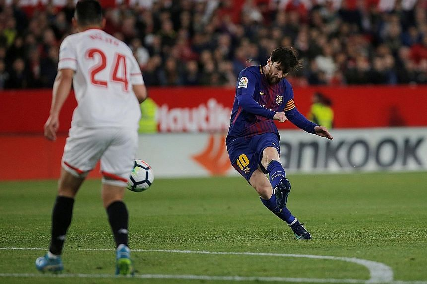 Barcelona substitute Lionel Messi striking from the edge of the box in the 89th minute. He scored to earn Barca a 2-2 draw at Sevilla.