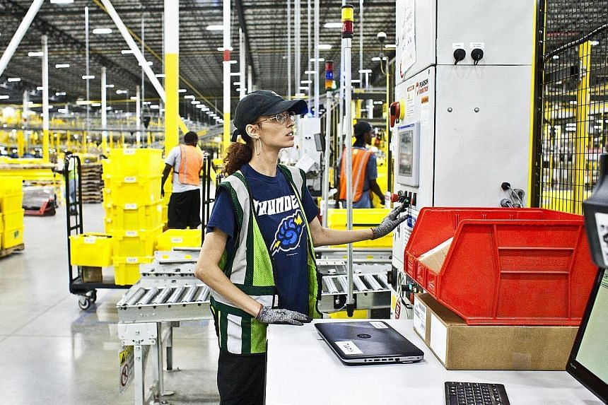 """An Amazon warehouse in Florence, New Jersey. US President Donald Trump tweeted that the online retailer """"must pay real costs (and taxes) now!"""" Mr Trump has been unhappy with Amazon over its use of the United States Postal Service."""