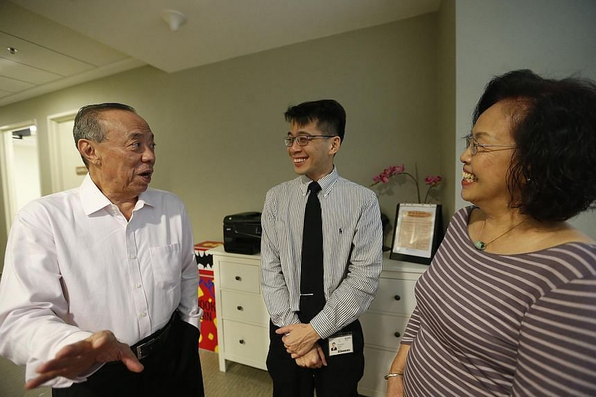 Madam Phang Yoke Fah and her husband Lie Tjoen-Jong, both colorectal cancer survivors, with Dr Tan Ker Kan (middle) of the National University Cancer Institute, Singapore. The couple said their brush with cancer underscores the importance of early de
