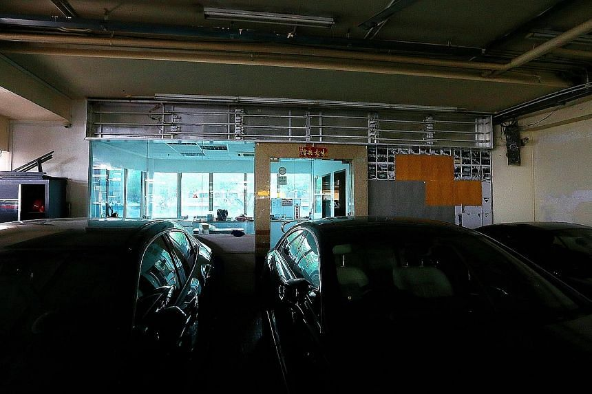 The signboard at Apex Car's premises in Ubi (above) has been removed, while at Novelty Auto in Kaki Bukit (below) the signboard hangs above an empty showroom. Novelty Auto has been operating for only about nine months. Case issued a public warning ag