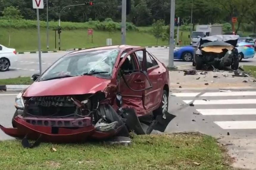 In the video, the front bumper of a red car had fallen off, and its passenger door was crushed and caved inwards.