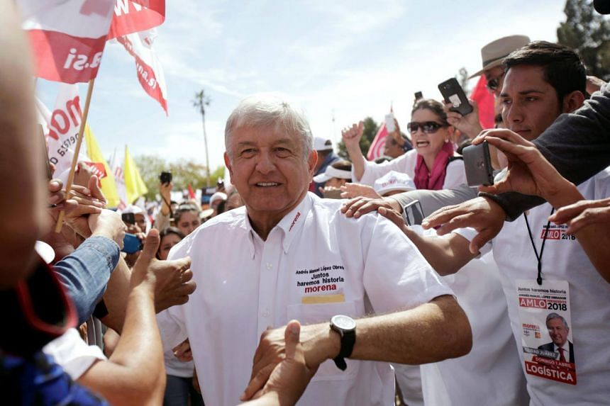 Leftist front-runner Andres Manuel Lopez Obrador of the National Regeneration Movement greets supporters during his campaign rally in Ciudad Juarez, Mexico on April 1, 2018.