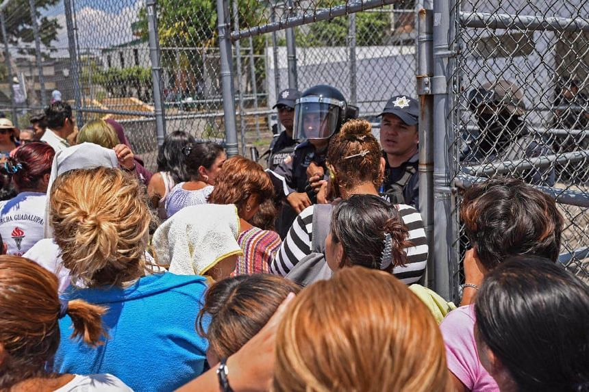 Relatives of prisoners wait for information outside La Toma prison in Veracruz State, Mexico, where a riot broke out.
