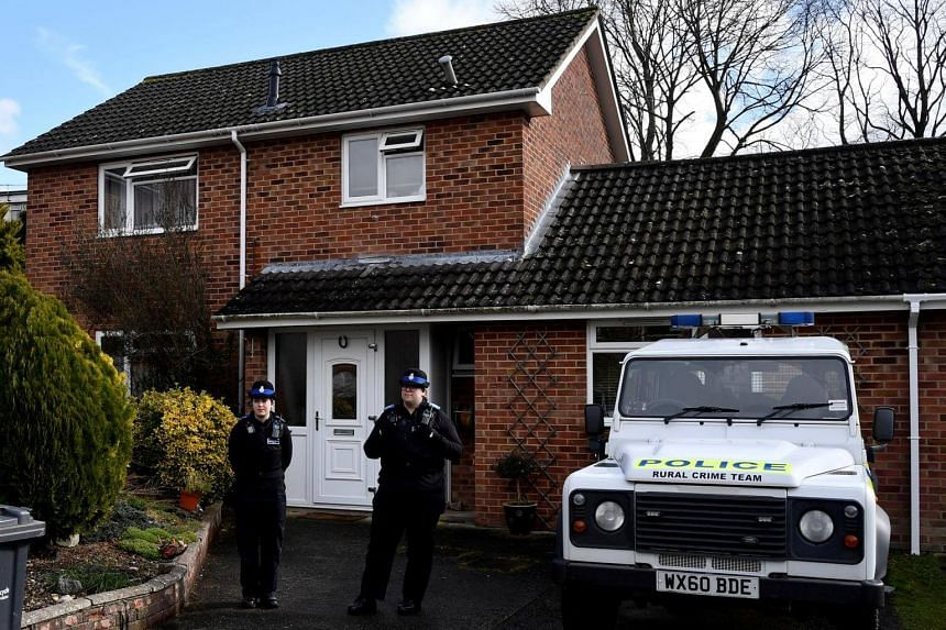 Police officers stand guard outside of the home of former Russian military intelligence officer Sergei Skripal in Salisbury, Britain.